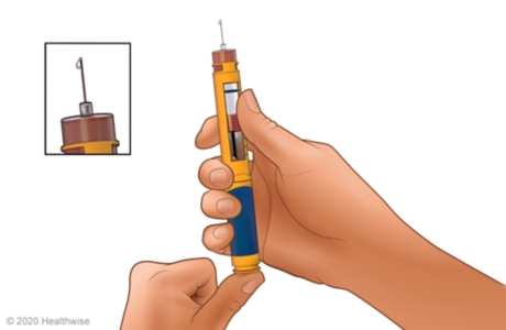 Priming the needle, with close-up of insulin coming out of the needle