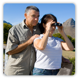 Photo of man with woman looking through binoculars