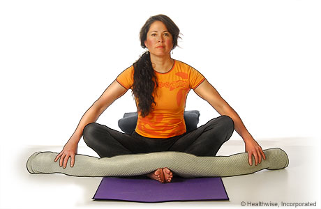Picture of a woman in step two of reclining bound angle yoga pose