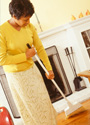 A woman sweeping the floor