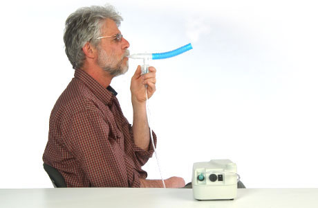 Picture of a man using a nebulizer