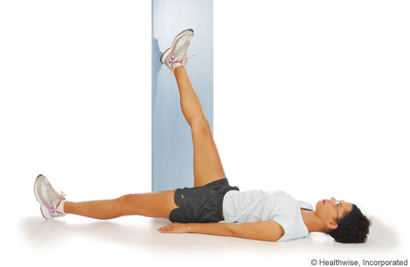 Picture of how to do a hamstring wall stretch