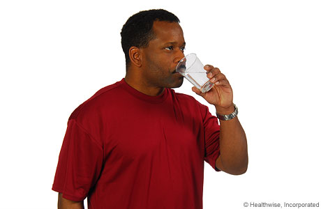 Picture of a man rinsing his mouth