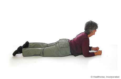 Picture of hip and back stretch for ankylosing spondylitis (front of hips on floor)