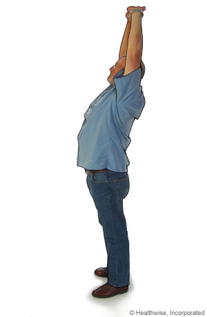 Picture of a standing overhead stretch to ease back aches and fatigue