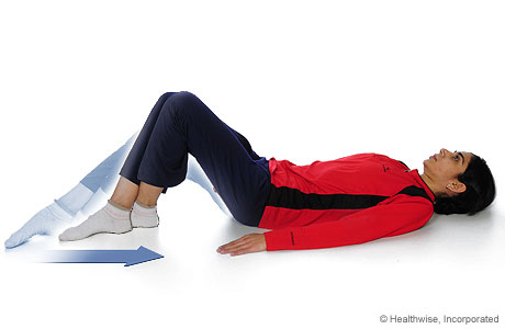 Picture of a woman doing the knee-flexion-with-heel-slide exercise