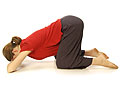 Picture of a woman leaning downward from a kneeling position