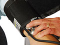 Picture of a blood pressure cuff that fits correctly